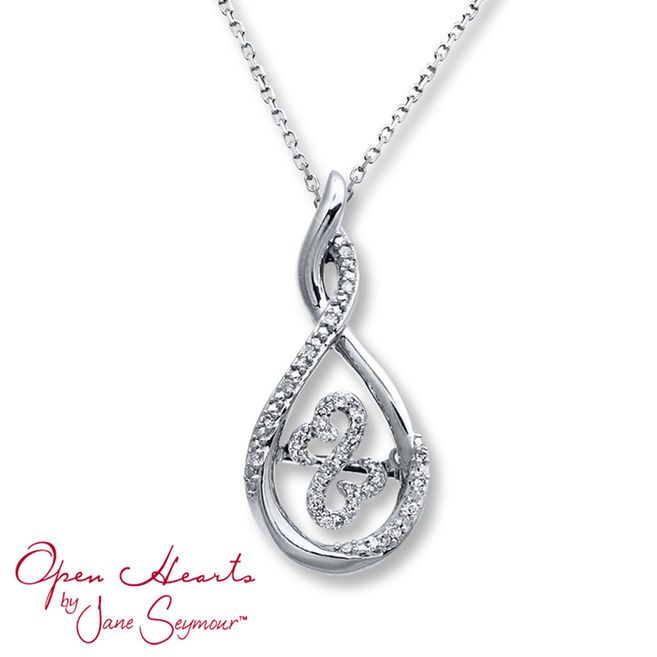 From Open Hearts Rhythm by Jane Seymour™, this necklace for her features the iconic Open Hearts design decorated in diamonds. The design moves, catching light from every angle, inside of a teardrop shimmering with additional round diamonds. Styled in sterling silver, the necklace has a total diamond weight of 1/10 carat. The pendant sways from an 18-inch box chain that secures with a lobster clasp. Diamond Total Carat Weight may range from .085 - .11 carats.