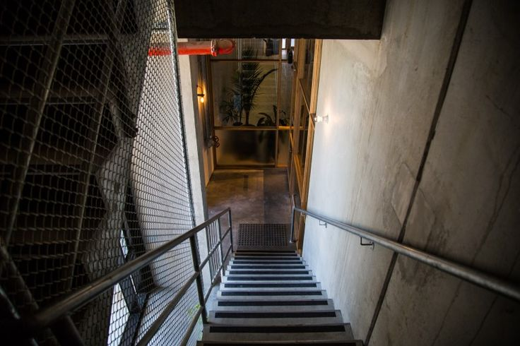 Untouched concrete decorated with measurements scribbled in pencil during construction lines the staircase up to the second floor (Photo: Nick Lavars/Gizmag.com)