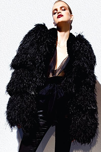 This a is a tom ford jacket and I love how it is really oversized and all the different layers of fur in the sleeves.