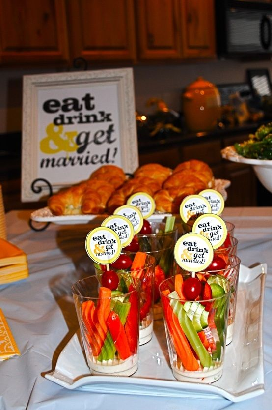Love the sign in the back, would be cute at the table with food at the bridal shower