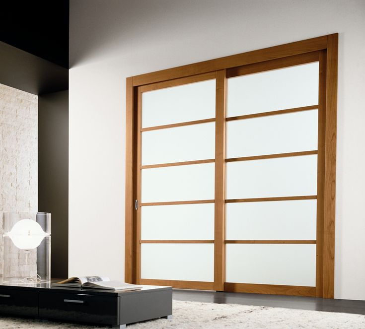 Modern Interior Sliding Door Featuring A Bianco Latte Panel With Cherry Wood Sliding Panel