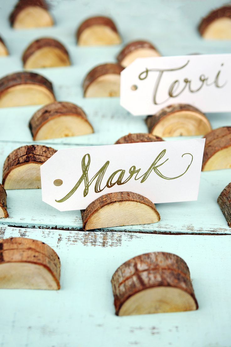 These wood place card holders are such a great idea for a rustic wedding.