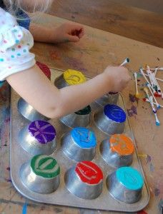 """Paint on muffin tin, draw in the paint with cotton buds, then take a print by laying paper over the top & pressing gently ("""",)"""