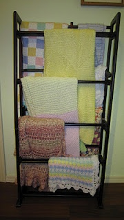 Upcycled DVD Rack into a Blanket Display.