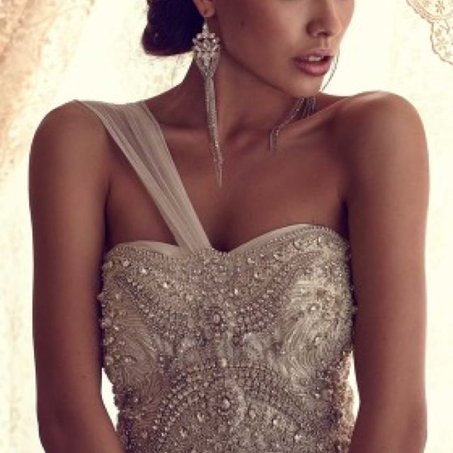 Jeweled wedding gown, giving it a slightly Indian touch