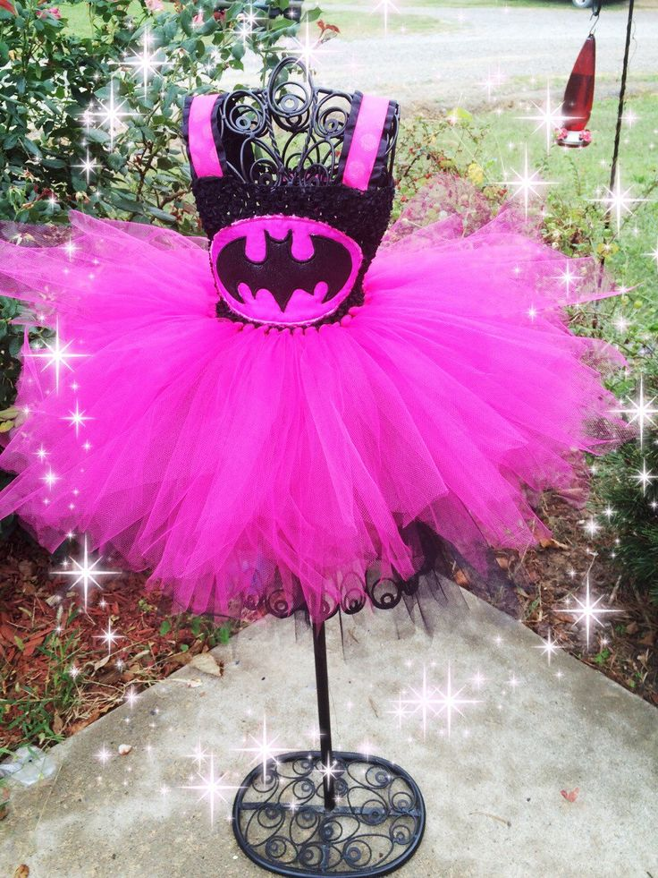 A personal favorite from my Etsy shop https://www.etsy.com/listing/251681486/pink-batman-inspired-tutu-dress-and