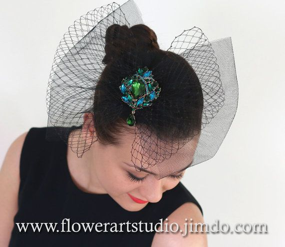 Handmade fascinator for black small hat, tulle and Russian veiling bows decorated with emerald green and turquoise rhinestones brooch. Currently available brooch colors: red, green, purple and black. Choose which one you like!  * * * * * * Small hat size is 12 cm / 4,7 in inches. Bow size is 28 cm / 11 in inches.  * * * * * * • On the backside of fascinator are alligator hair clips. • This fascinator is unique handmade! • This item is ready to ship. • Please note that real colours may differ…