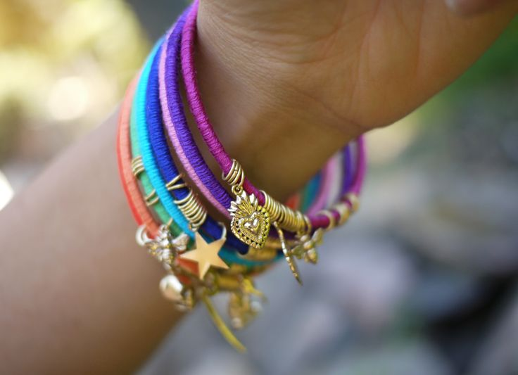 wrapped bangles with charms...love the mix of colors and the charms are great for showing the personality of the wearer...lovin' this bracelet thang :)