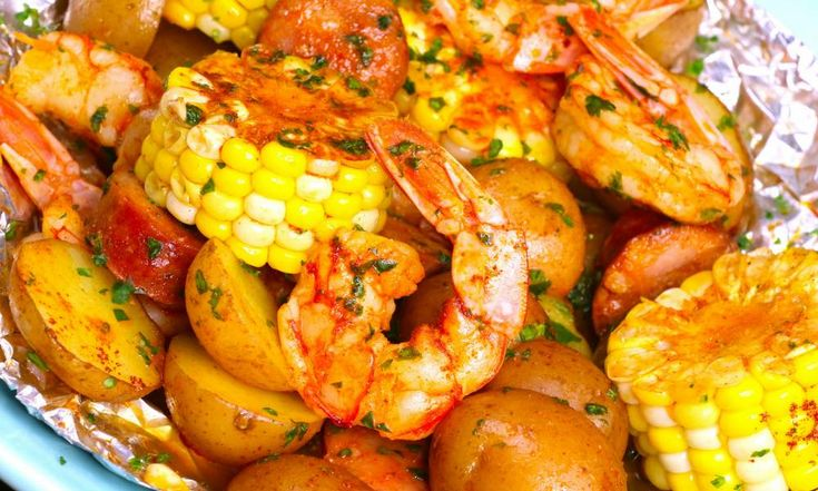 20 Minute Shrimp Boil Foil Packets Recipe  with Video The Best Shrimp Boil with corn potatoes and sausage - easily made on the grill or oven in foil packets. Perfect for a party!