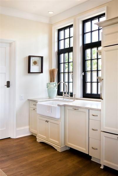 Dark wood on the windows + clean white kitchen + right up my alley. #Kitchen