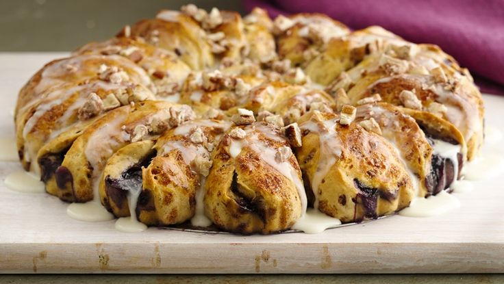 Blueberry Cinnamon Roll Coffee Cake recipe from Pillsbury.com   I'm going to try this with strawberry preserve I have tonight :)
