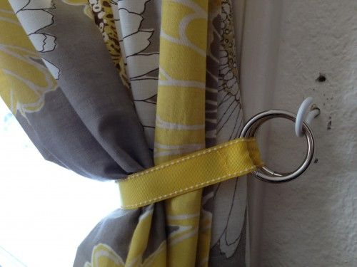 """Twisted a spare hook into the hole. By hand, I sewed the ends of the ribbon so they attached to metal rings"""