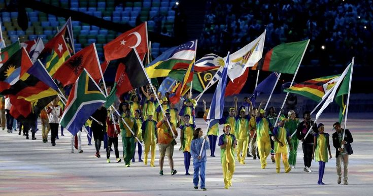 Despite the rain, Team GB, led out by four-time Olympian flag-bearer Kate…