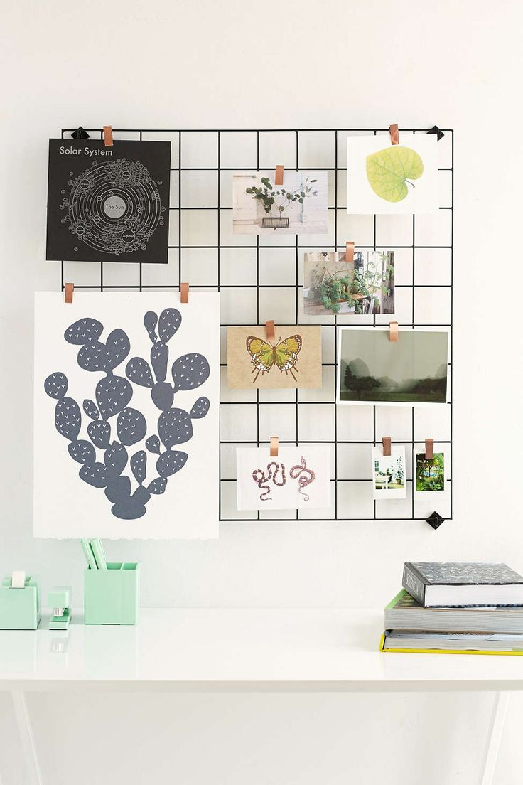 UrbanOutfitters.com: I could easily do this by spray painting old wire shelving that I have and using mini clothespins