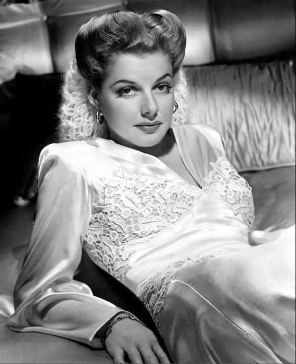 "Ann Sheridan, ""The Oomph Girl."" Starred in ""Angels With Dirty Faces,"" ""Kings Row,"" ""The Man Who Came to Dinner,"" ""Edge of Darkness,"" ""Silver River,"" and Nora Prentiss."""