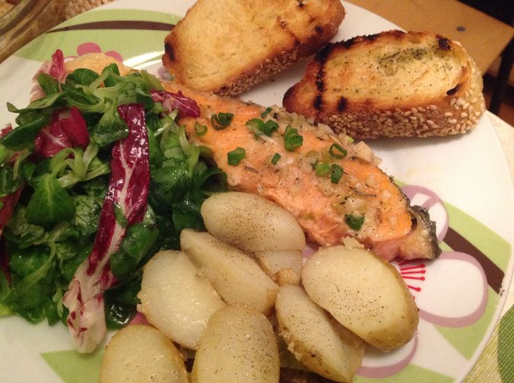 Butter garlic salmon Roasted potatoes Salad Bread