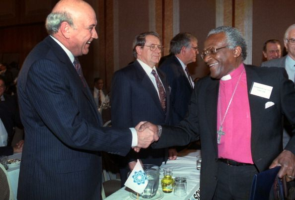 South African President Frederik Willem de Klerk greets Archbishop Desmond Tutu at the historic peace convention of all the main political parties in...
