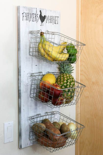 """Hmm...basket display for produce? It would free up counter space and the wire baskets minus the distressed wood and """"farmer's market"""" verbiage would add a more modern feel."""