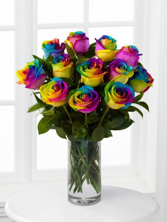 Rainbow Roses..I think I would fall In Love with anyone who sent me a dozen of these:)