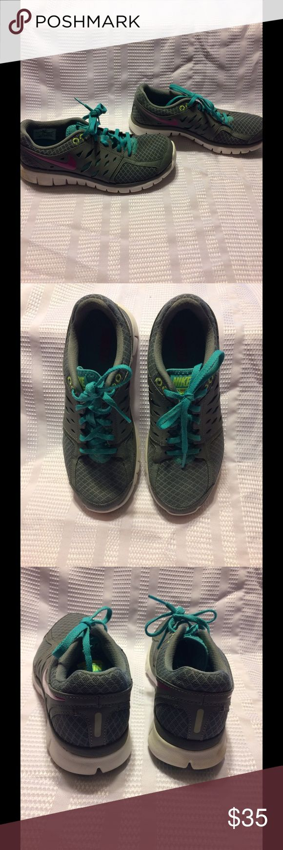 """Nike Flex Run size 7. Nike Flex Run in colors gray,aqua and pink shoes with white soles in excellent condition only worn twice to the gym before my daughter decided that was not what she wanted to do """"KIDS"""" her loss can be your gain these are in excellent to new condition. Nike Shoes Athletic Shoes"""