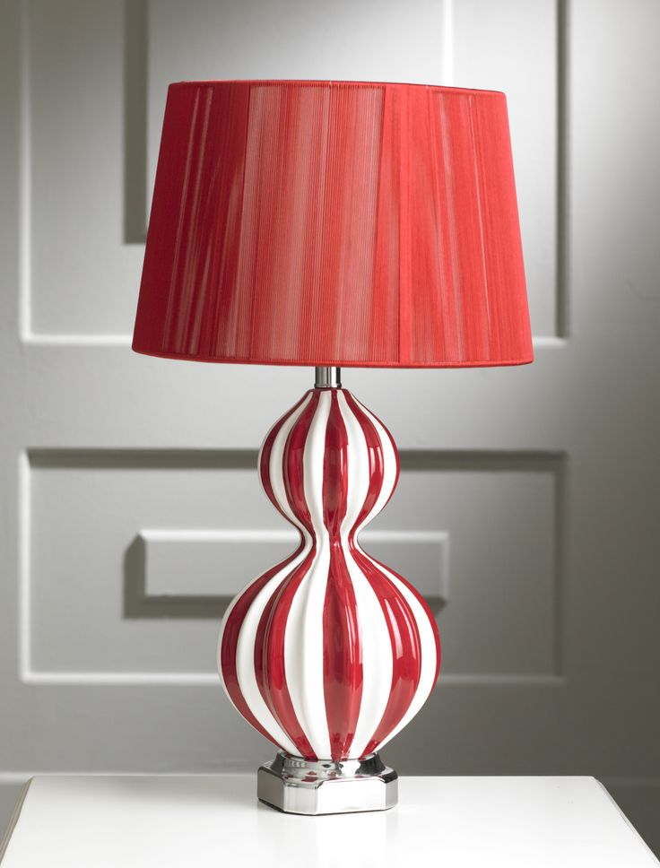 This new marble red and white table lamp is a new addition to our lighting range. The lamp has a red and white base vertically striped glass type shape with a slim waist, seated on a discreet chrome effect section. The lamp is complemented by a plain red shade. The lamp has a standard fitting and is supplied without a bulb.