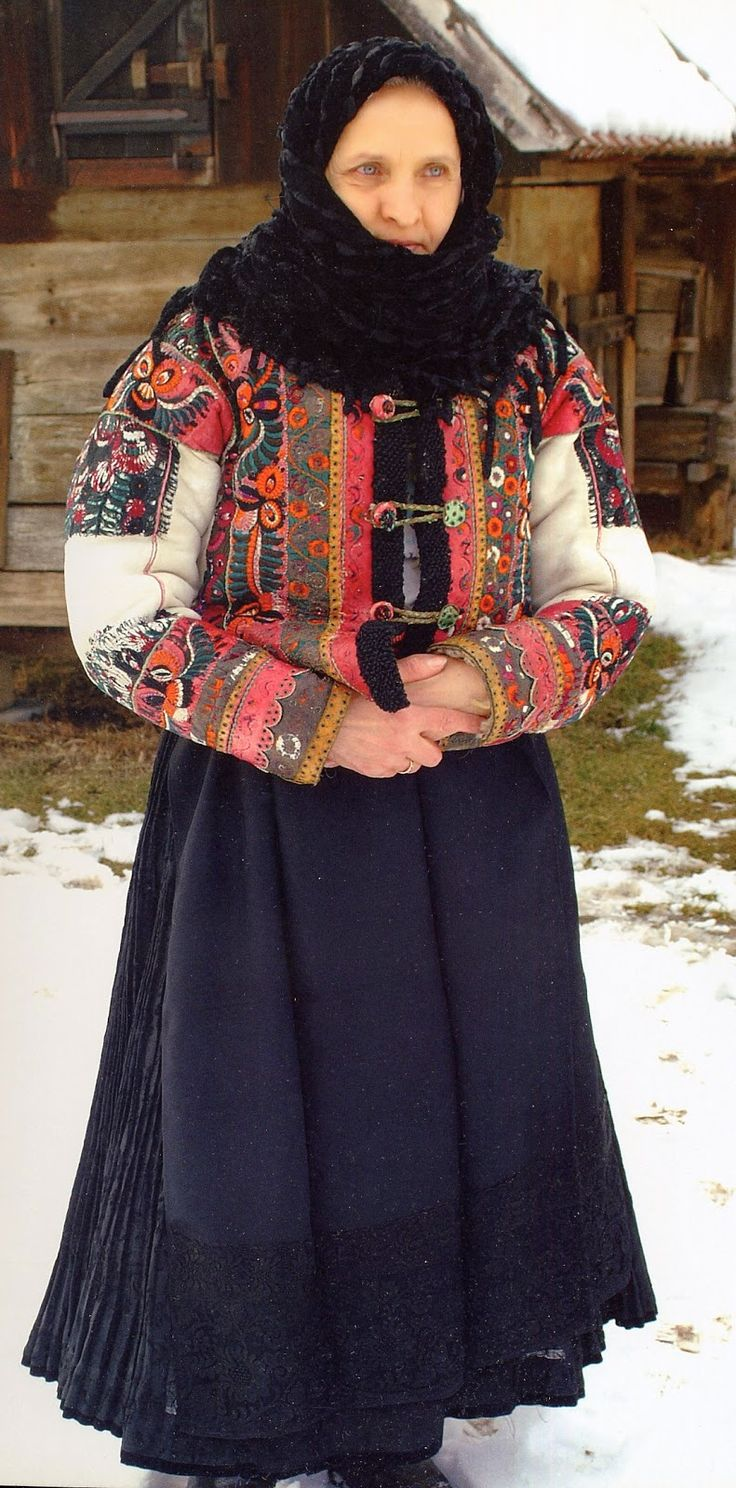 At first glance, this woman seems to be wearing a plain black apron, but in fact, the lower panel has typical Matyo embroidery in black on black.