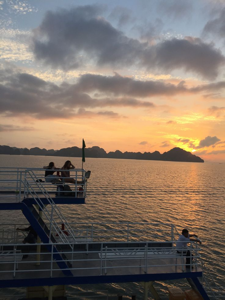 sunset on the ferry to halong bay