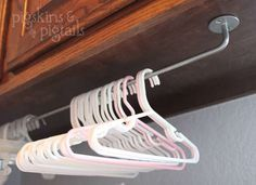 Laundry Room Hangers...Hanger Hangout...Hangers are a must-have, but without a specified place to live, they can become a laundry room's biggest annoyance. Mount a wall rail, towel holder, or spare curtain rod underneath your cabinets or in a small stretch of wall to corral unruly hangers. As a bonus, this convenient spot can also serve as a space-saving drying rack.