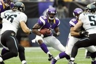 Minnesota Vikings running back Adrian Peterson, center, runs the ball during the first half of an NFL football game against the Jacksonville Jaguars, Sunday, Sept. 9, 2012, in Minneapolis. (AP Photo/Genevieve Ross)