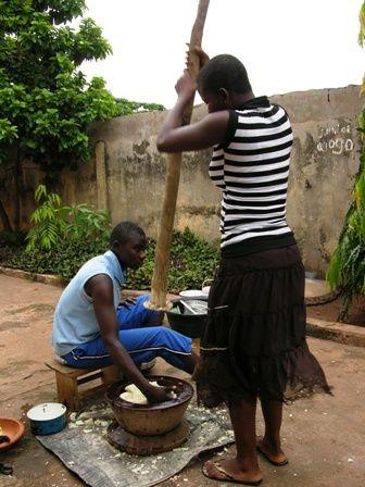 Ghanian women pounding fufu.