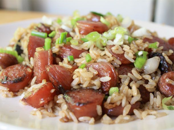 2 or 3 links of Chineses sausage, cut into 1/4 inch slices 4 cloves garlic, minced 4 cups cold cooked rice 2 tablespoons light soy sauce 1/2 teaspoon salt 1/4 teaspoon sugar 1/4 teaspoon white pepper