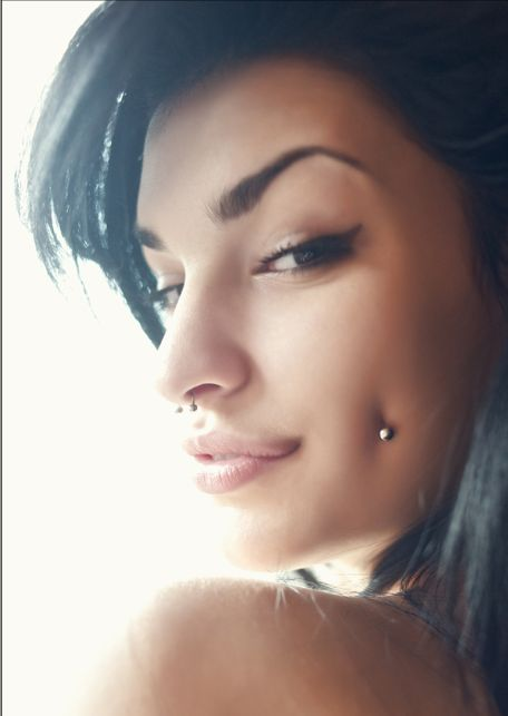 I'm in love with the septum, I want one so bad. And the dimples piercing is Legit.