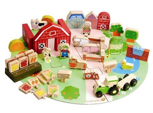 Everearth Organic Farm Play Set                Tweet this Toys2Learn Product!      We love this organic farm set.  Complete with 53 pieces  Includes: A stable with barn Vegetable patch with healthy vegies One farmer doll A range of  wooden farm animals including a dog, cow, cat, duck and a duck phone, pig and sheep Trees Compost bin Harvester.  Hours of fun and learning
