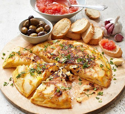 Spanish tortilla recipe: This classic omelette, filled with pan-fried potatoes and onion, makes a delicious light vegetarian meal or tapas bite http://www.bbcgoodfood.com/recipes/spanish-tortilla
