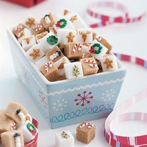sugar cubes w royal icing piping. Let dry overnight before painting red stripes on candy canes.