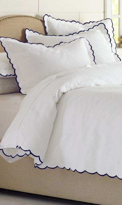 Finish your guest or master bed with the classic, clean design of the white Isabel coverlet and pillow sham detailed with romantic scalloped edges and colorful embroidered trim.