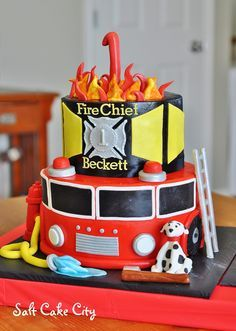 Salt Cake City (www.SaltCakeCity.com) firefighter birthday cake. Firetruck bottom tier with sugar dalmatian