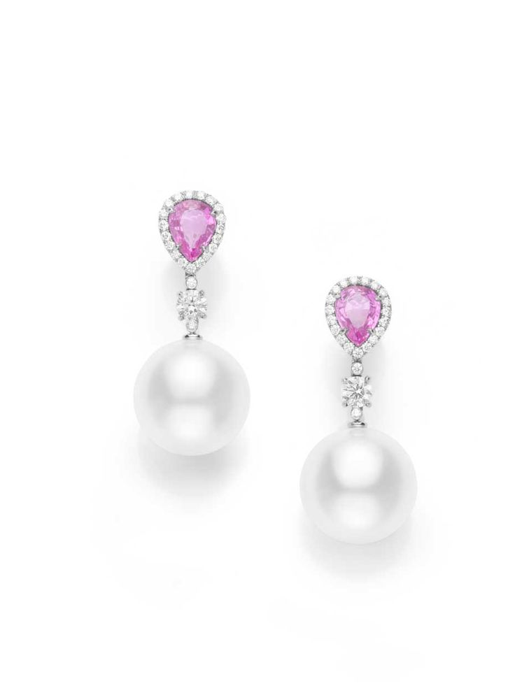 A pair of pink sapphires add an intriguing pop of colour to these mikimoto pearl and diamond earrings.