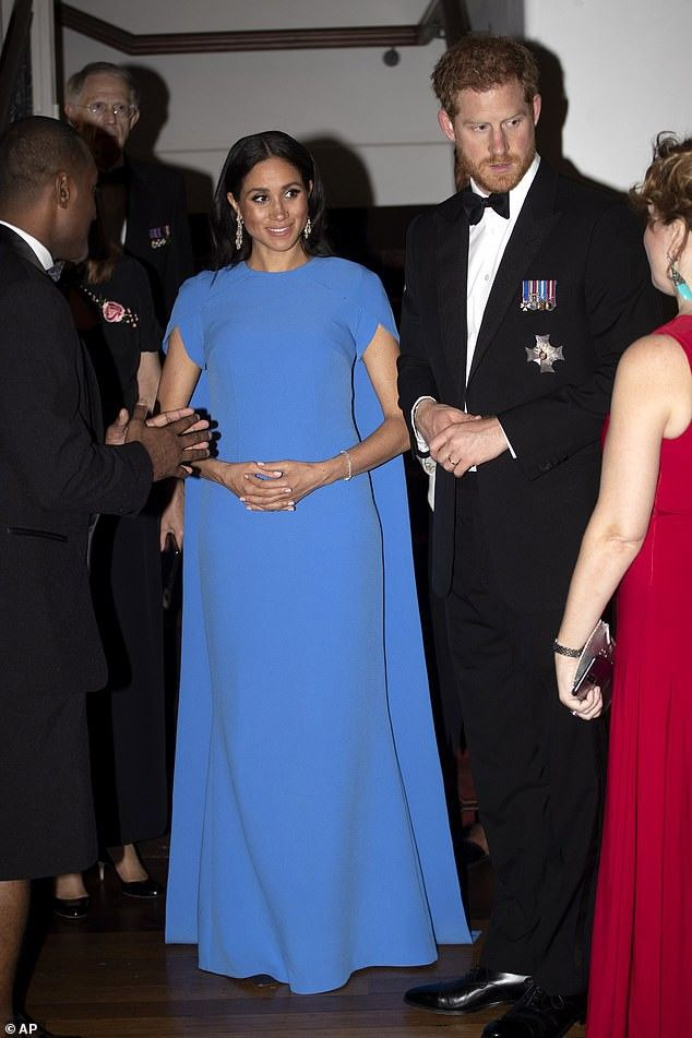 10232018 Meghan Chose An Elegant Caped Gown For Her First Black