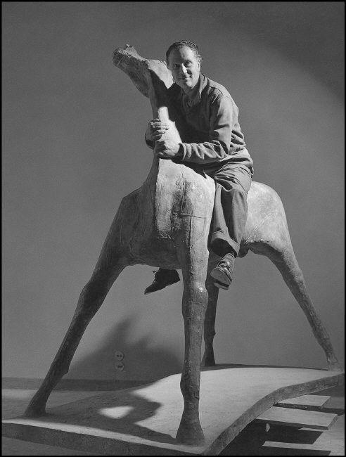 Marino Marini in his studio on one of his horses (Milan, Italy 1952.)  Photo by Herbert List