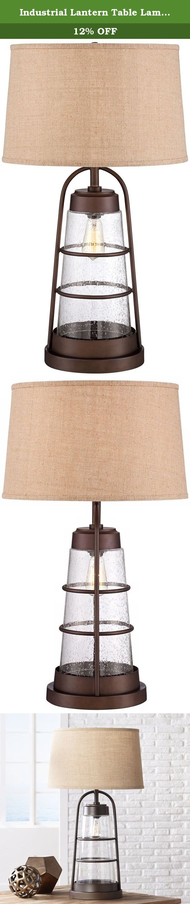 "Industrial Lantern Table Lamp with Night Light. Charm and convenience combine in this lantern-style table lamp. The industrial design features a cage-like base, wrapped around seeded glass, with an Edison bulb to light your way during the nighttime hours. A handsome burlap shade sits atop the design in a streamlined drum shape. - 31"" high x 10"" wide round base. - Shade is 16"" across the top, 18"" across the bottom, 11"" on the slant. - Takes one 150 watt medium base bulb (not included). -..."