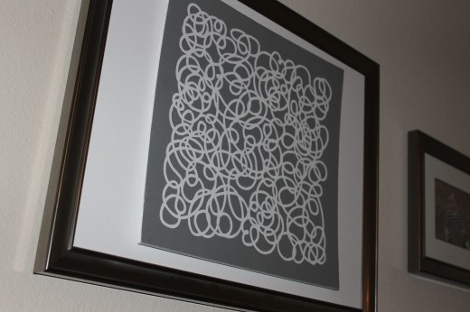 DIY artwork using lace cardstock, foamboard and a frame.
