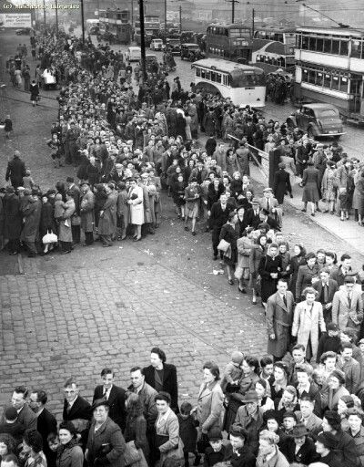 Queues at Belle Vue 1946, look at the different forms of transport, Busses, trams, coaches and trams. Manchester.