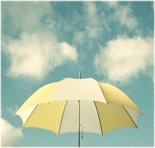 umbrella, pastel yellow, white, blue sky summer clouds