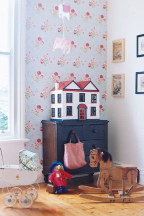 Take inspiration from this charming Ballarat home and make a pretty feature wall in your child's bedroom with floral wallpaper. A range of patterns and designs can be found at Laura Ashley. Vintage finds like this dollhouse and rocking chair add touches of nostalgia. Photography by Mark Roper.