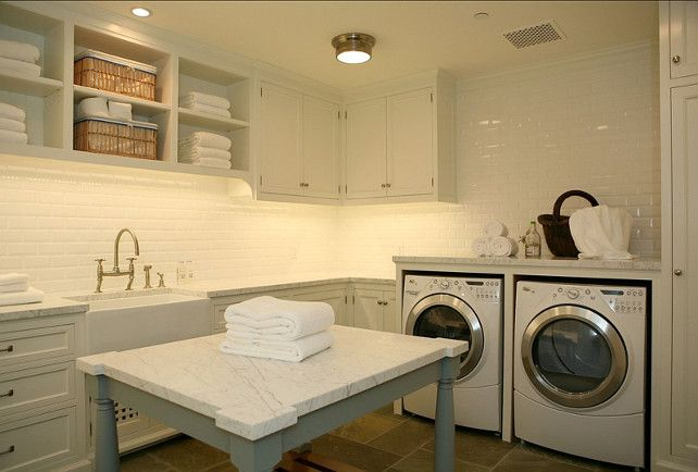 I'm completely obsessed with this laundry room... Island  for folding, sink, plenty  of counter space, cabinets...