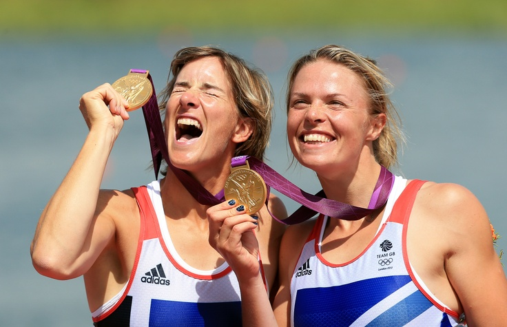 Great Britain's Katherine Grainger (left) and Anna Watkins celebrate winning gold in the women's double sculls at Eton Dorney Rowing Lake, Windsor.