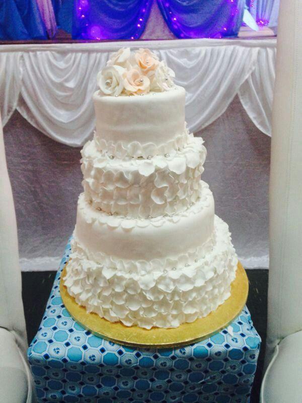 Pure white rose petal wedding cake