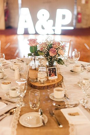 Vintage Pastel rustic table centrepieces Paul and Ann us pretty barn wedding at Larchfield