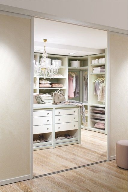 love chandeliers in closets and bathrooms.  love the shoe storage under the island drawers
